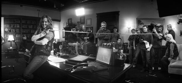 File:24- Marci, Jon Cassar and crew measure Oval Office set.jpg