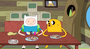 S5 e5 Finn and Jake at the table with noodles and tiny people