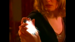The Collector glowing in Mel's hand.