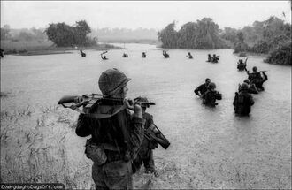 Vietnam-War-Paratroopers-Water-Rain-Rifles