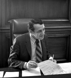 Harvey Milk in 1978 at Mayor Moscone's Desk crop