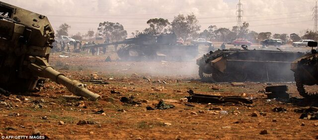 File:Destroyed Libyan tanks south of Benghazi (SIADD).jpg