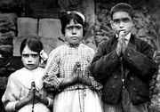 Fatima children with rosaries
