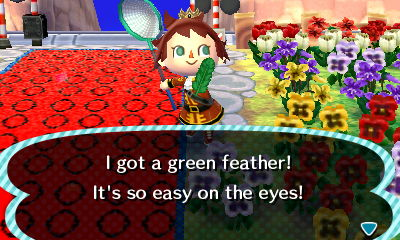 File:Player catches green feather.JPG