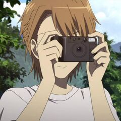 Naoya takes a picture.