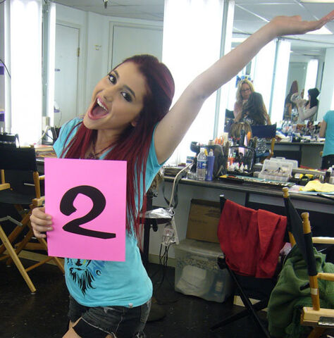 File:Ariana holding a number 2 card.jpg