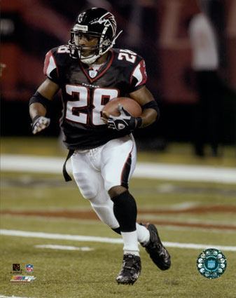 File:AAFY009~Warrick-Dunn-Action-with-ball-Posters.jpg