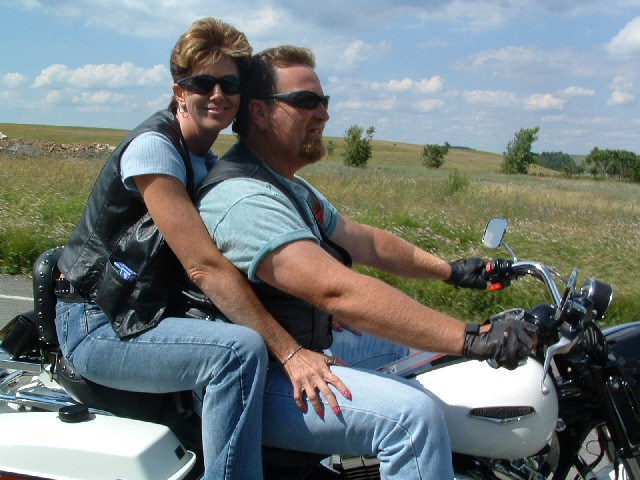 File:1203553260 Mary & brett on bike.jpg