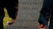 Oliver Queen and Helena Bertinelli visit Sara Lance's tombstone