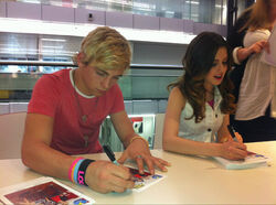 Raura signing autographs