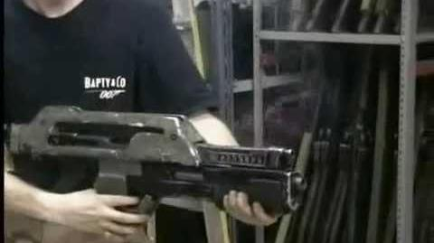 The Prop Store's Ian firing a Pulse Rifle from the sci-fi classic Aliens