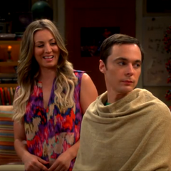 Penny giving Sheldon a haircut.