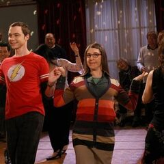 Sheldon and a drunk Amy dancing together.