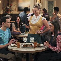 Penny serving Amy and Sheldon during their date night.