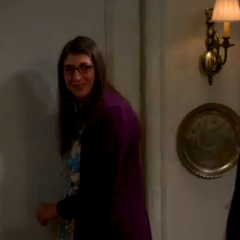 Amy's smile after Sheldon spanks her again.