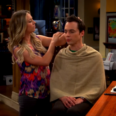 Penny giving Sheldon a new look.