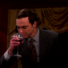 Romance: Sheldon drinking wine.