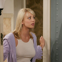 Penny at Sheldon's apartment door.