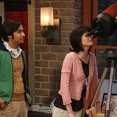 Raj showing Lucy the cosmos.