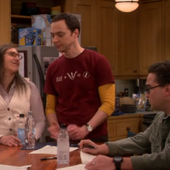 Amy smiling at Sheldon's joke.