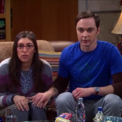Sheldon holding Amy's hand for the first time.