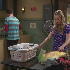 Sheldon and Penny doing their laundry.