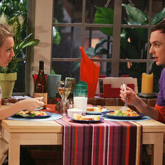 Sheldon having spaghetti (with little pieces of hit dog cut up in it) with Penny.