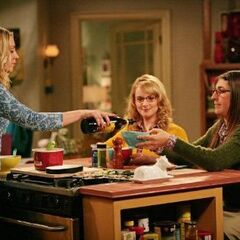 Penny pouring Amy a drink.