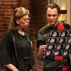 Sheldon looking at brain scans with Beverly.