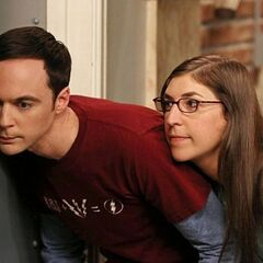 Sheldon and Amy spying on Penny.