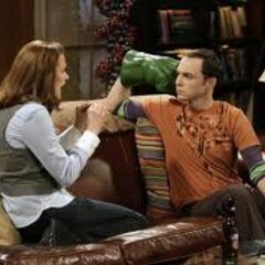 Sheldon and his mixer date wearing Hulk hands.