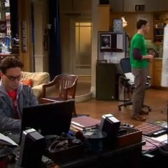 Leonard working on his laptop, as Sheldon works on Quantum Physics.