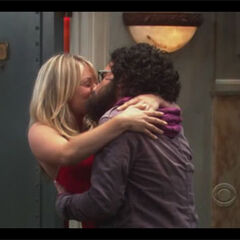 Penny kisses Leonard.