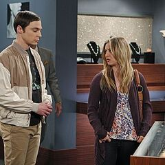 Penny helping Sheldon by Amy an apology gift.