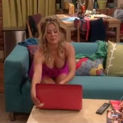 Sexy Penny reaches for her laptop.