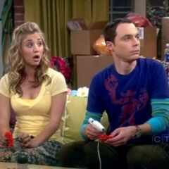 Sheldon working with Penny.
