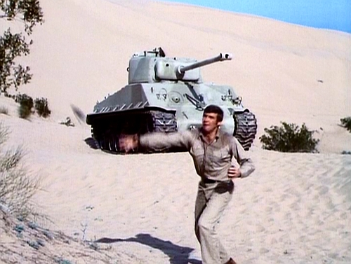 File:The Moon and the Desert - Steve throwing grenade.jpg