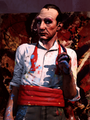 Burial at Sea Cohen in front of a painting.png