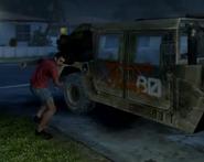 Civilian vandalizing Humvee BOII