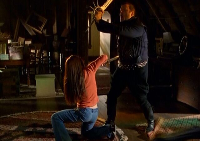 File:Piper vanquishing head executioner demon in the attic.JPG