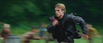 Peeta running in the Games