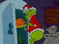 Grinch taking the roast beast