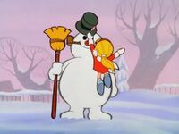 Karen gives the hat to Frosty