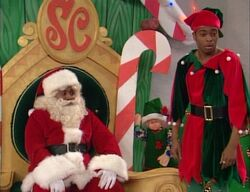 Kenan and Kel as Santa and his helper