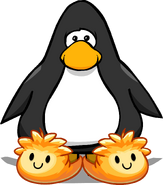 Orange Puffle Slippers on a Player Card