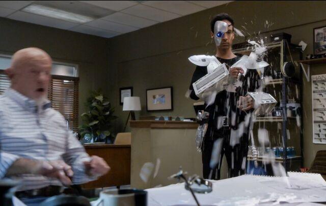 File:5X7 Abed sprays Hickey's desk.jpg
