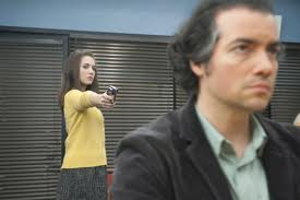 File:Conspiracy Theories and Interior Designs Annie points gun at Professor Garrity.jpeg