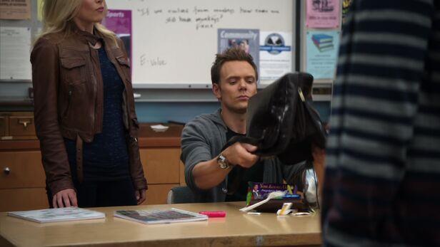 File:Jeff dumps Shirley's bag.jpg