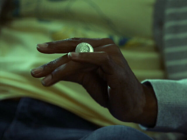 File:5x03-Abed rolls quarter across fingers.jpg