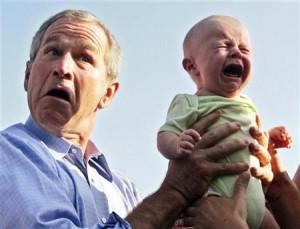 File:Bush-holding-crying-baby-300x229.jpg